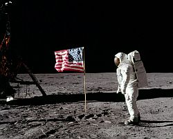 Aldrin in front of the US flag